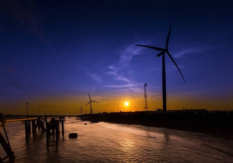 Wind turbines at Port of Tilbury at sunset