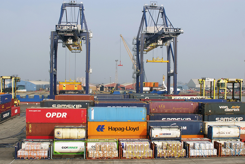 colourful container boxes with 2 gantry cranes in the background