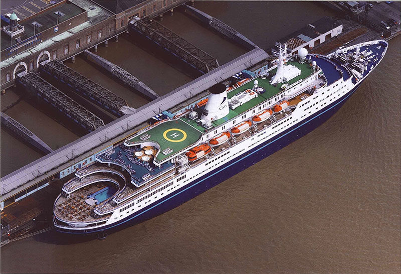 a Navy blue cruise ship at London Cruise Terminal