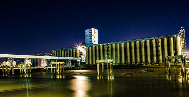 the Grain Terminal at Port of Tilbury at night, viewed from the River Thames