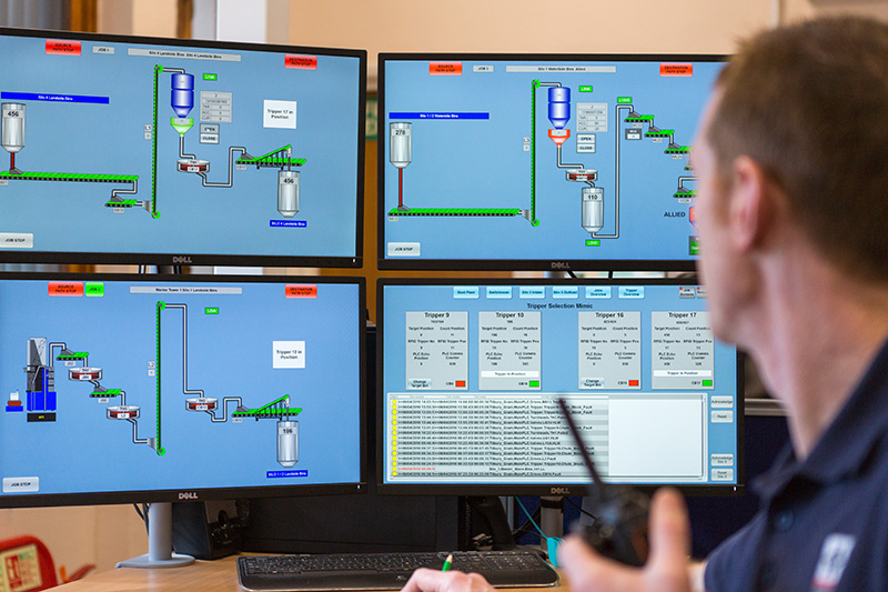 a person sitting at a computer operating the SCADA system at Tilbury Grain Terminal