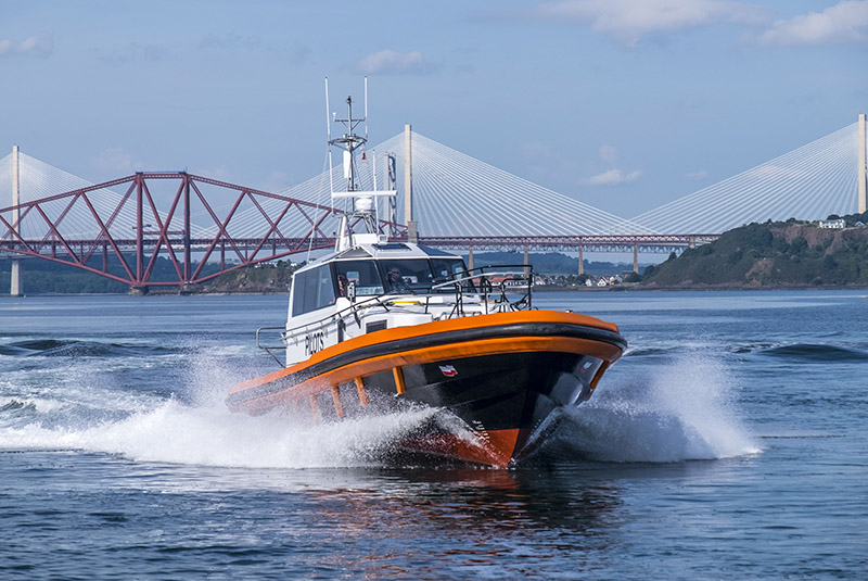 a new Forth Ports Pilot vessel with the Forth Rail Bridge in the background