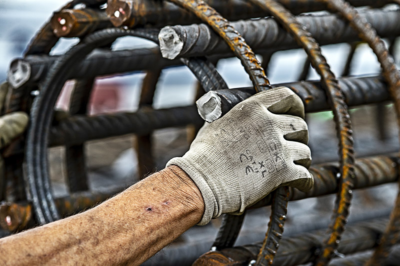 Gloved hand on metal