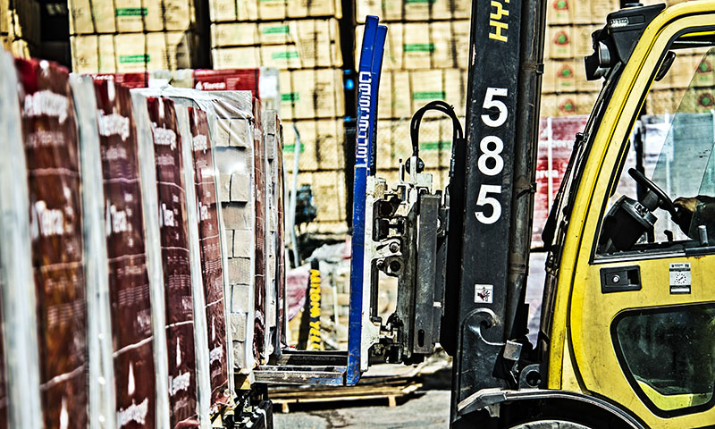 Fork lift truck picking forest products