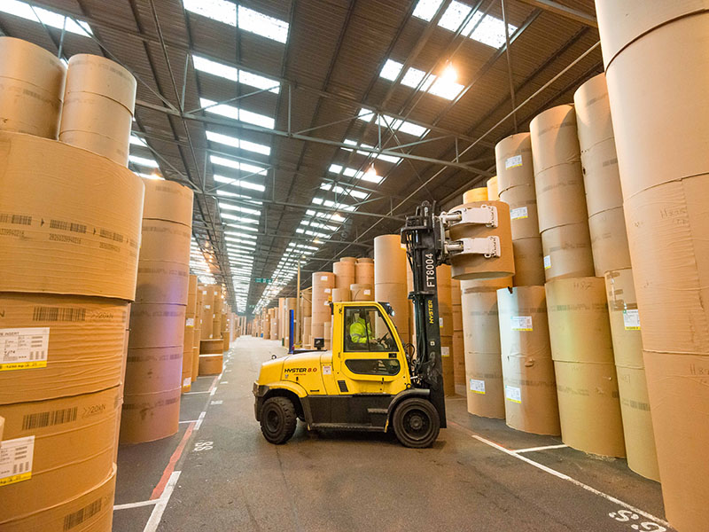 Forklift truck lifting paper roll